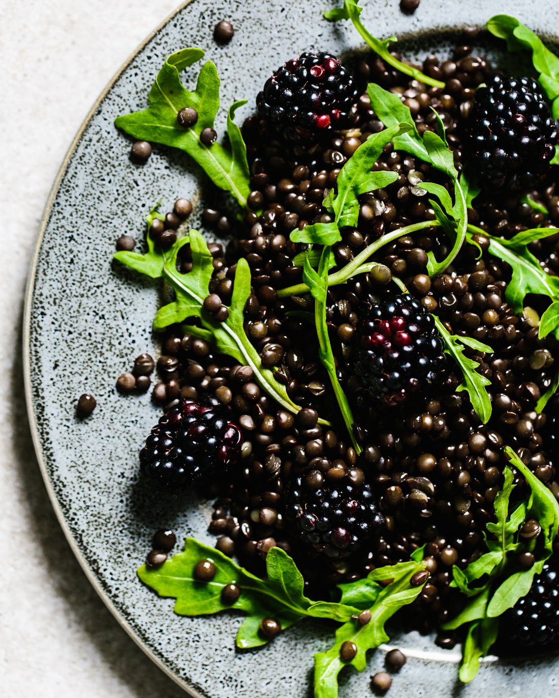 piroggi.com | beluga lentil salad with blackberry, arugula and peach dressing